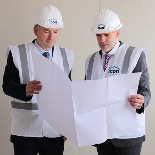 Two Surveyors working on-site